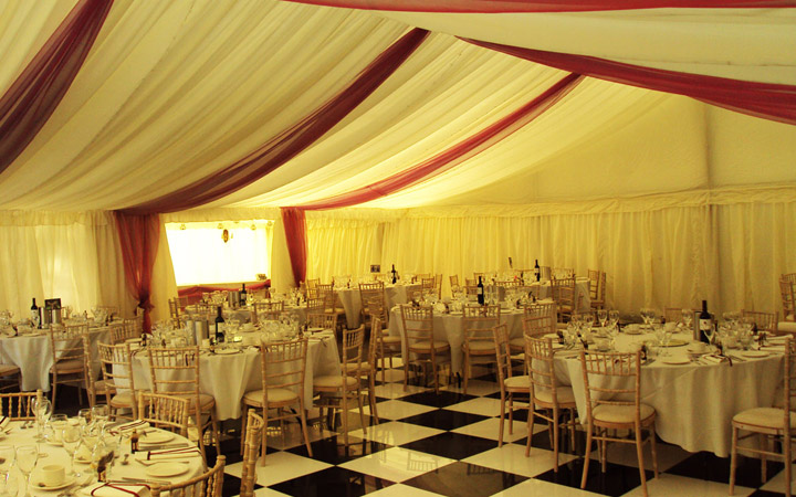 Marquee Dance Floor with Tables and Chairs